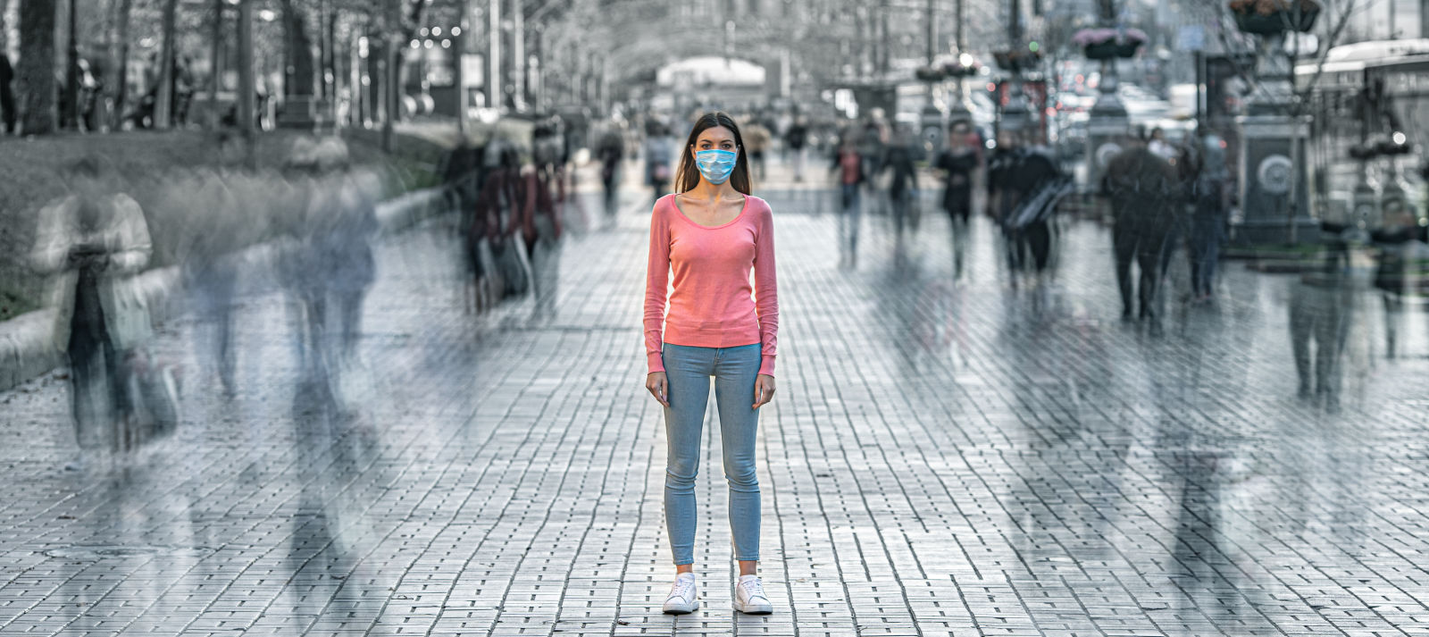Impressions and Other Assets/coronavirus_covid_mask_young_woman_aloone_street_city_crowd_AdobeStock_329119752_etrjgu