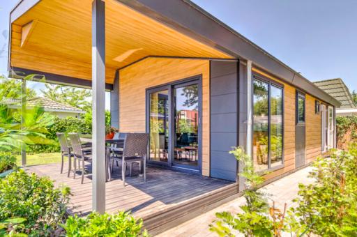 Deze knusse bungalow heeft een privé jacuzzi en ligt vlakbij de Efteling!