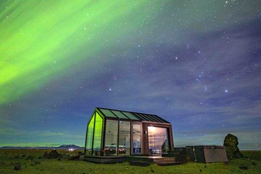 Check out this glass cottage in Iceland w/stunning views and a hot tub!