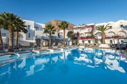Romantic luxury Santorini 5* hotel w/flights and breakfast
